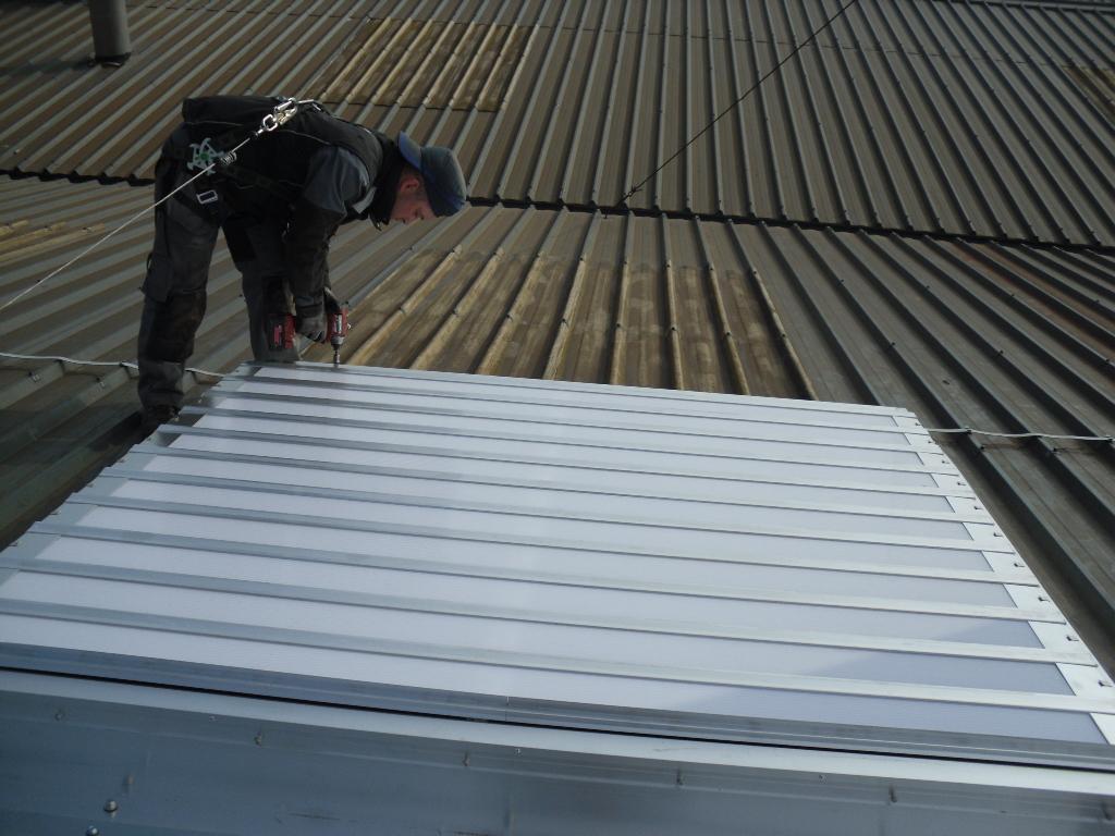 Pose exutoire lames toiture